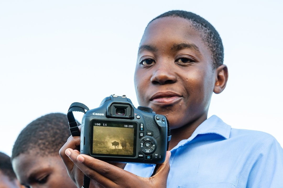 Ricky Tibane showing his photography captured during Reserve tour